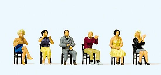Sitzende Zuschauer, applaudierend